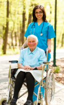 Elder in wheelchair and a caregiver