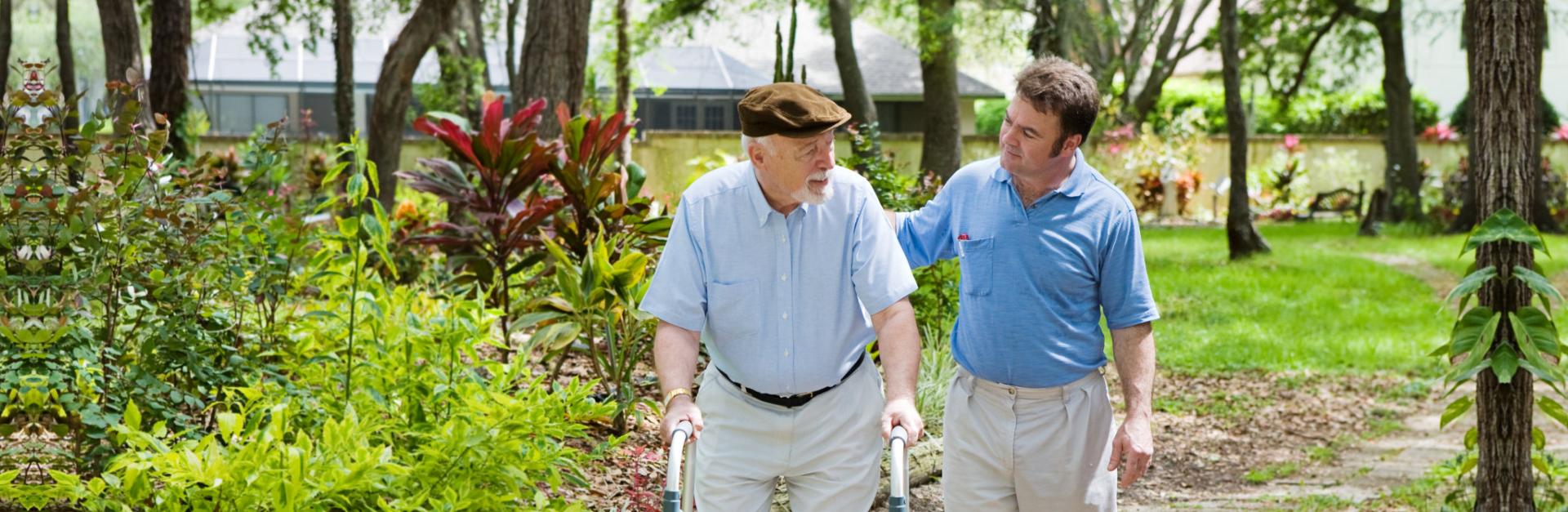 Caregiver and elder walking in the garden