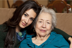 Elder and caregiver smiling
